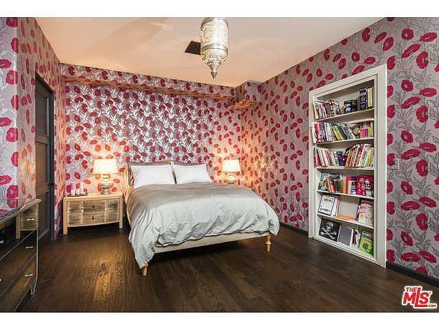 Thanks to the pink floral wallpaper, there isn't a lack of pattern in this bedroom! Source: Coldwell Banker