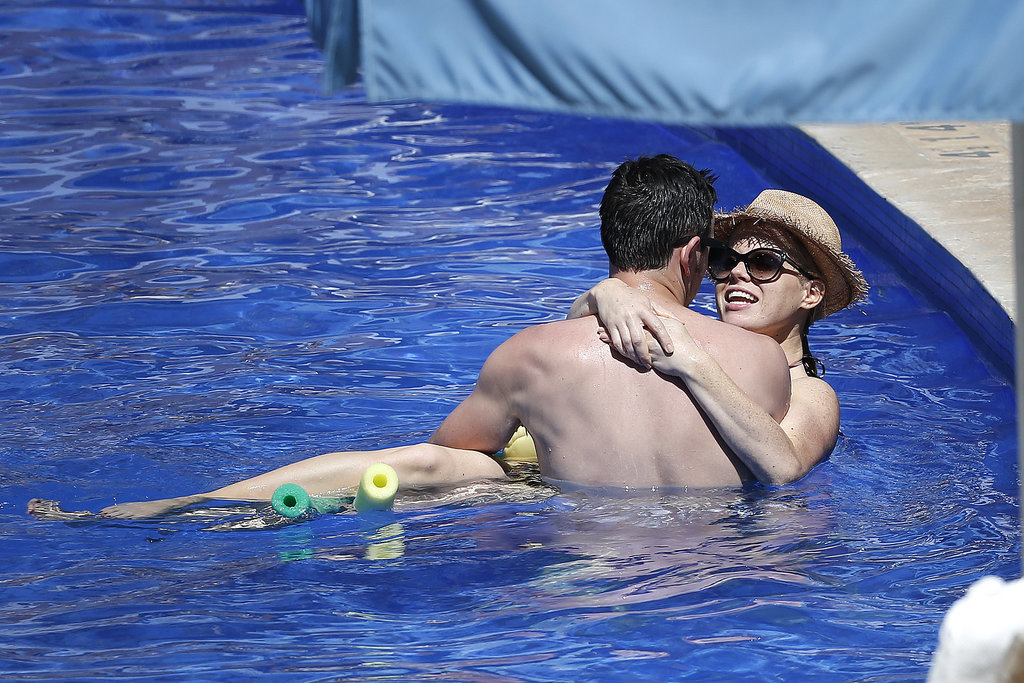 During a trip to Hawaii in May 2013, Megan Hilty cuddled up with her now-husband Brian Gallagher.