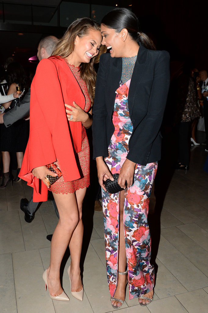 Chrissy Teigen and Rachel Roy laughed together at the supper.