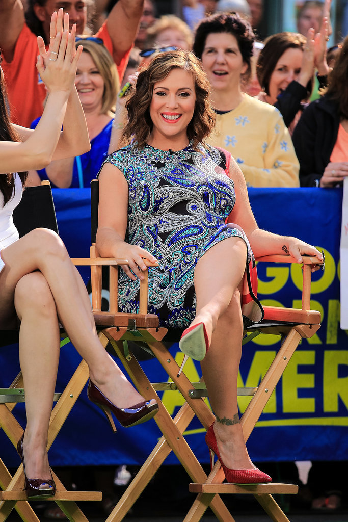 Alyssa Milano showed off her baby bump on Good Morning America in NYC on Monday.