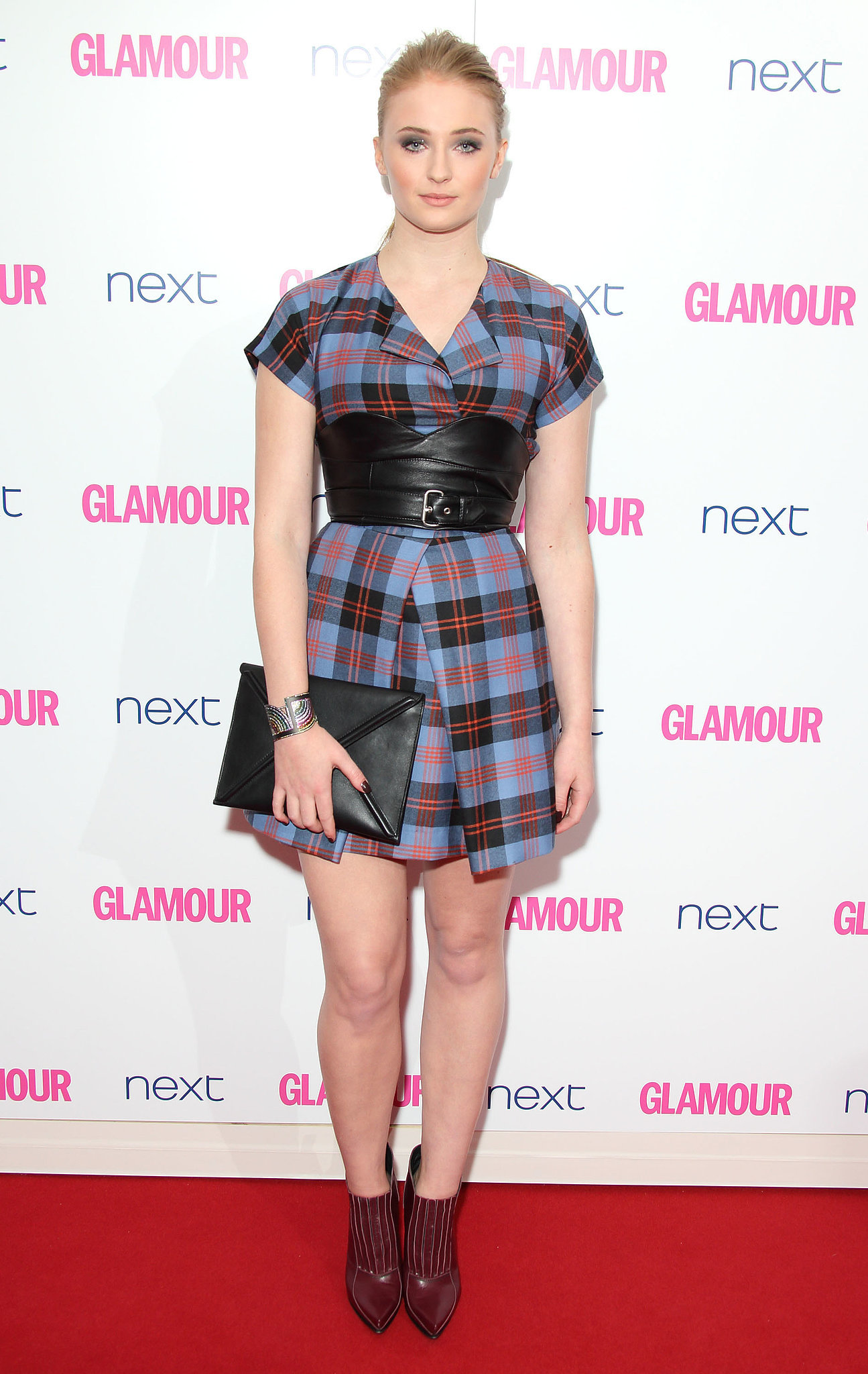 Game of Thrones star Sophie Turner wore a plaid dress.