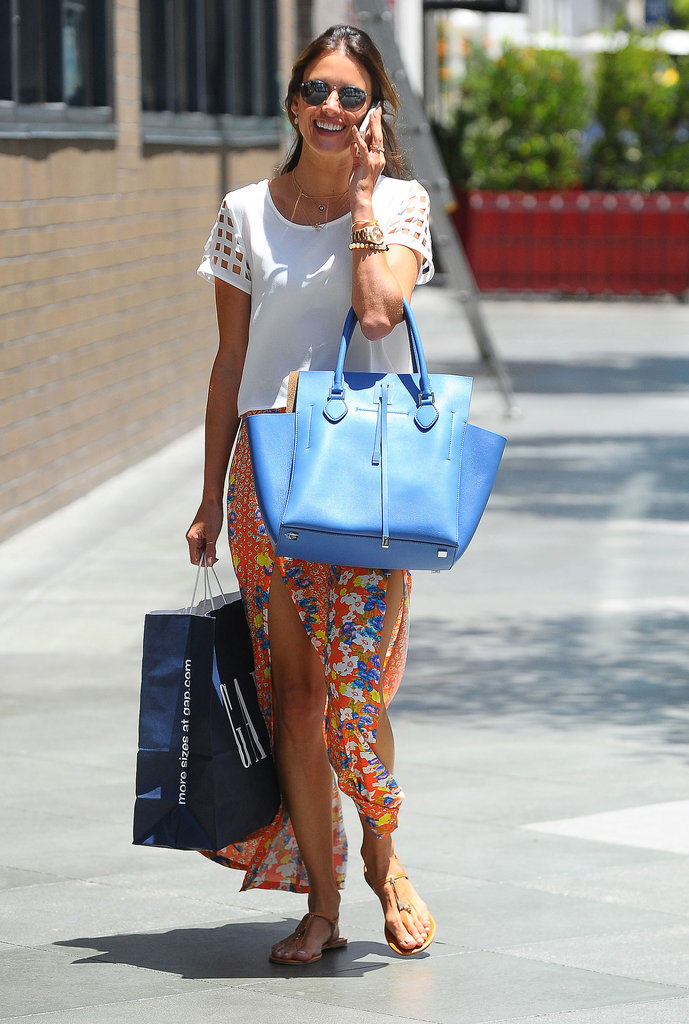 Alessandra Ambrosio giggled on the phone on Wednesday out in LA.