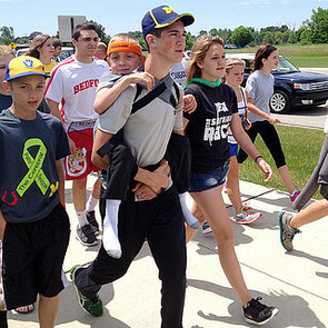 Teen Carries Brother For Cerebral Palsy Walk