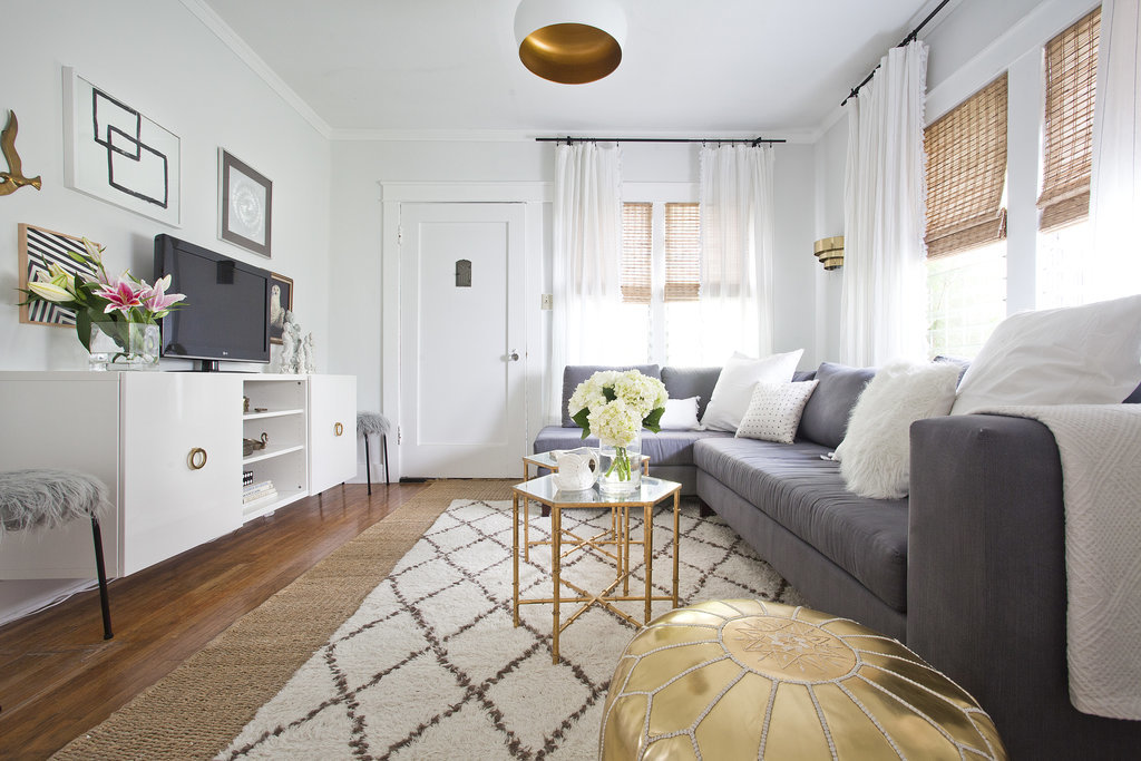 Aside from large pieces like a coffee table, unexpected metallic touches, like the inner rim of the light fixture, complete this glam yet sophisticated space.  Source:  Bethany Nauert via Homepolish