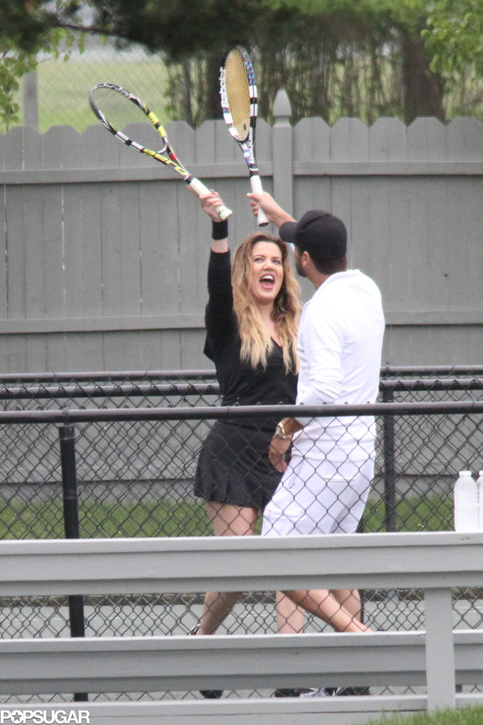 Khloé Kardashian and Scott Disick high fived with their tennis rackets in the Hamptons on Thursday.