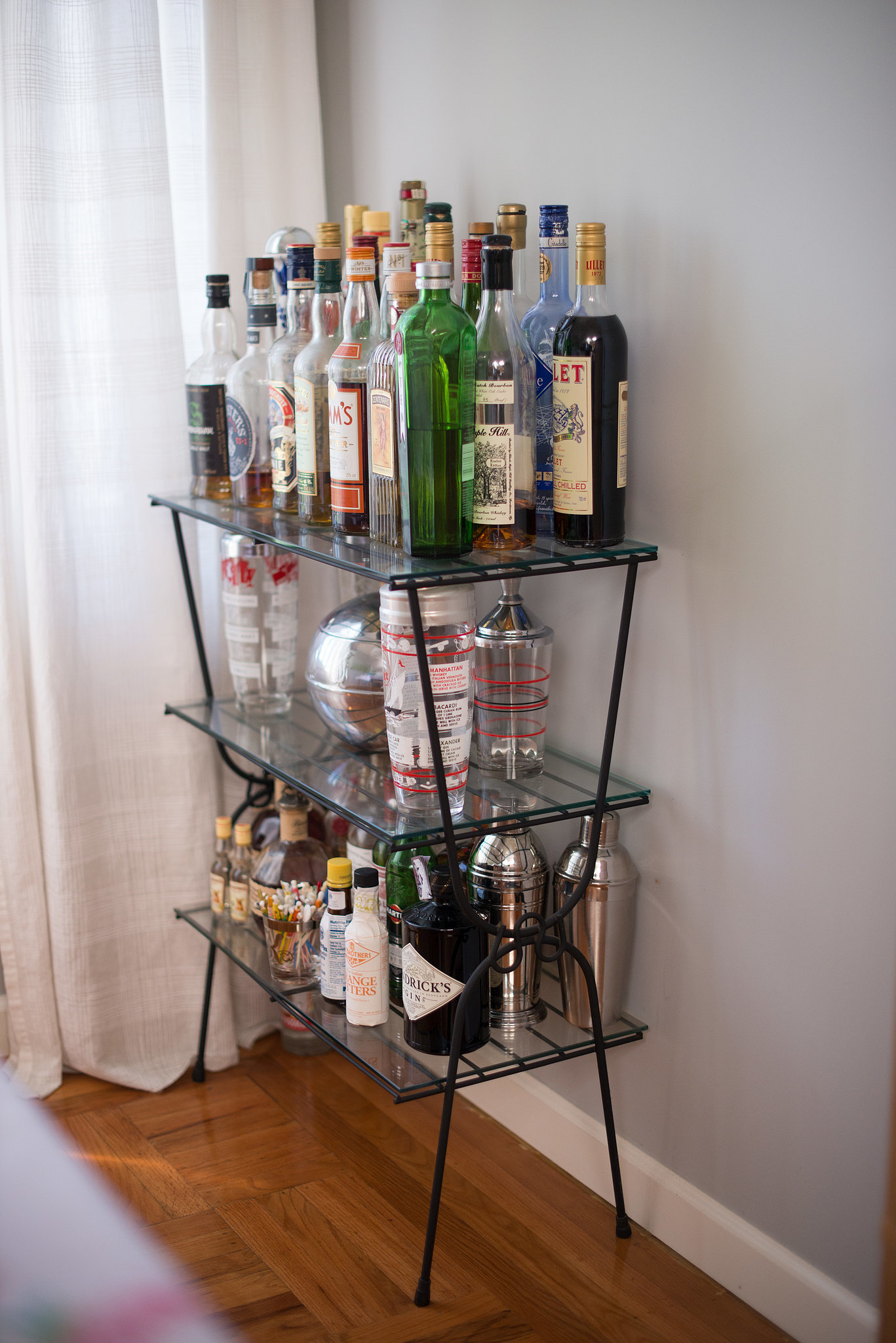 Look at those legs! Even the three-tiered bar cart gives off a retro feel.  Source: Kristen Loken