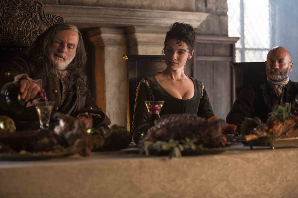 Colum MacKenzie (far left) and Dougal MacKenzie (far right) welcome Claire to their castle.  Courtesy of Starz