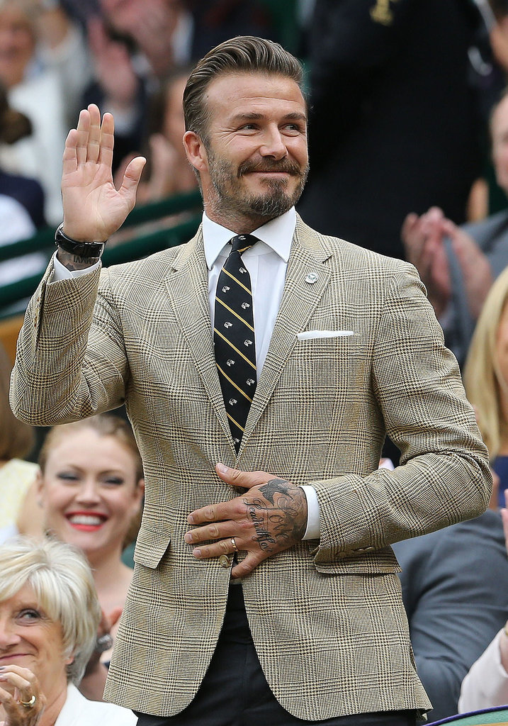 David Beckham looked dapper while watching a match at Wimbledon on Saturday.