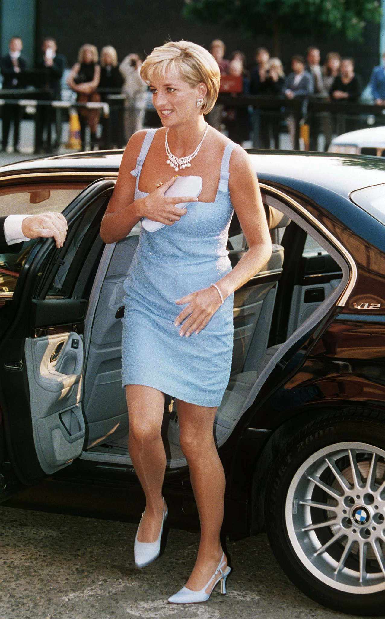 Diana lets her powder blue number speak for itself with complementing heels and simple accessories — a satin clutch and, of course, an adornment of pearls. Source: Getty/Anwar Hussein