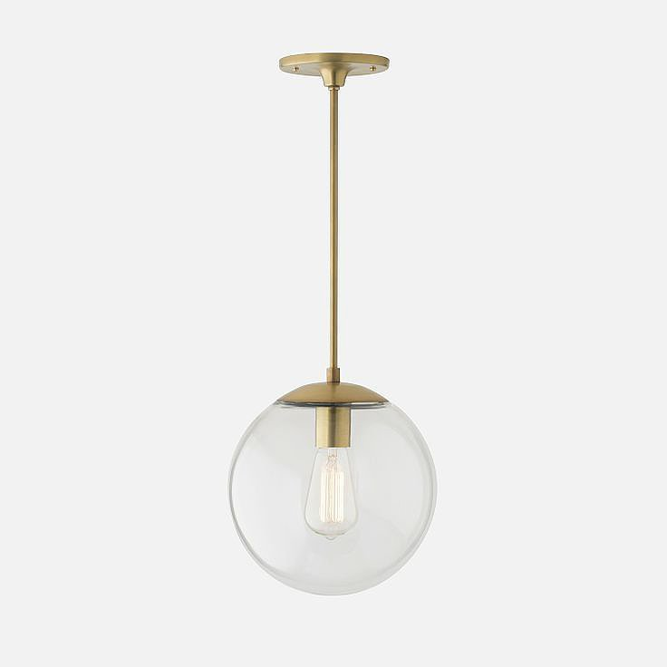 My latest lighting crushes can be summed up in a single phrase: minimal with a side of glamour. I can honestly picture this brass beauty working in any room. — Angela Elias, associate editor