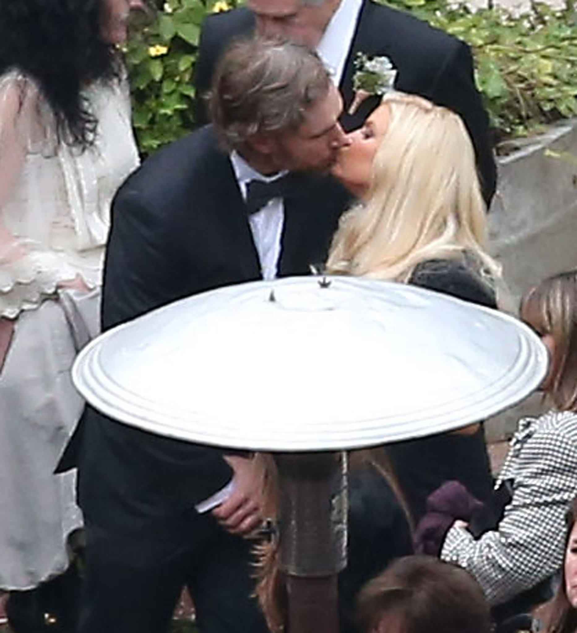 They shared a cute kiss at the December 2012 wedding of Jessica's best friend, CaCee Cobb, and actor Donald Faison in LA.