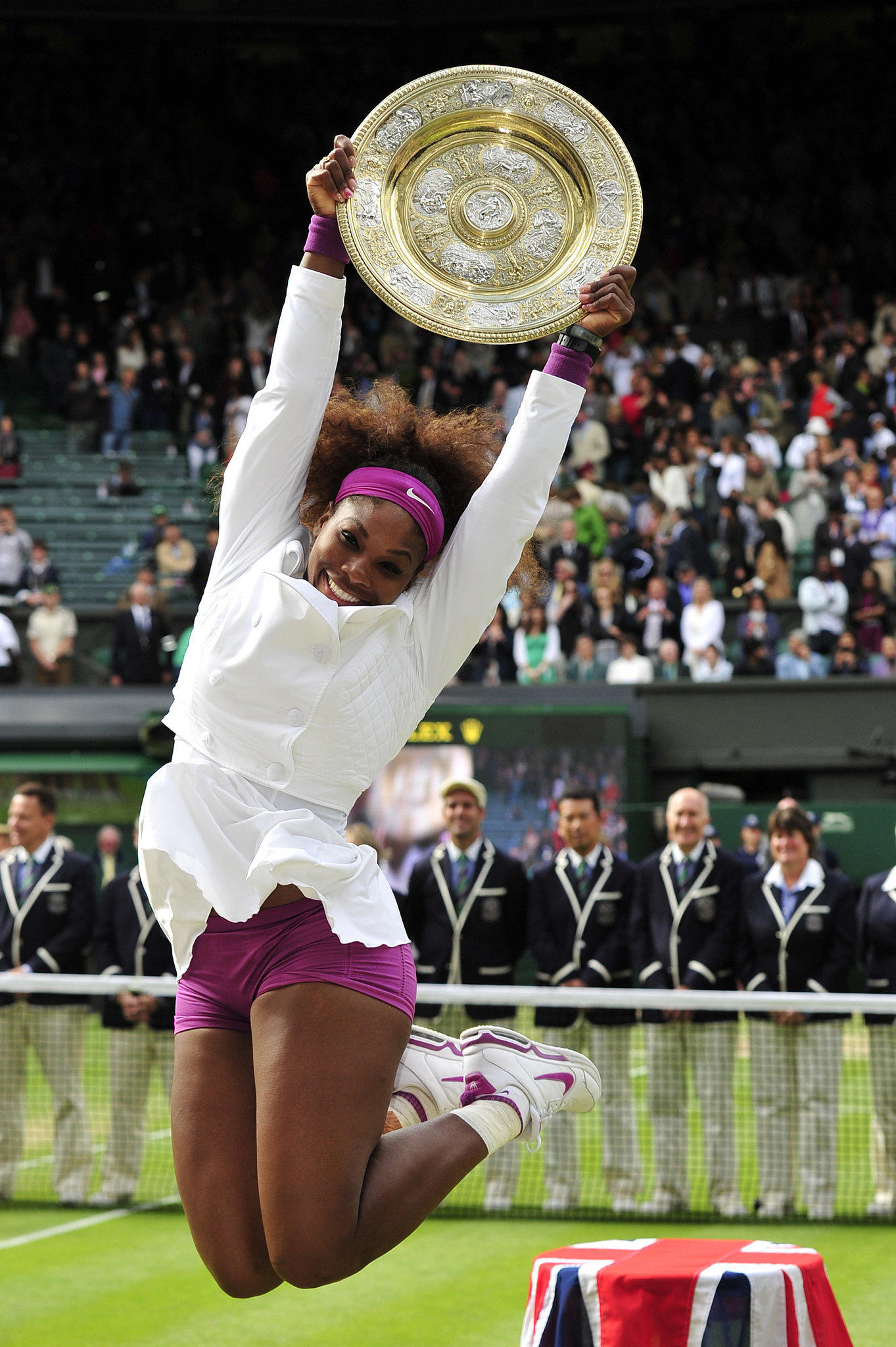 Serena Williams jumped for joy in a cute white and purple tennis ensemble as she celebrated her women's singles final victory at the 2012 Wimbledon championship tournament.