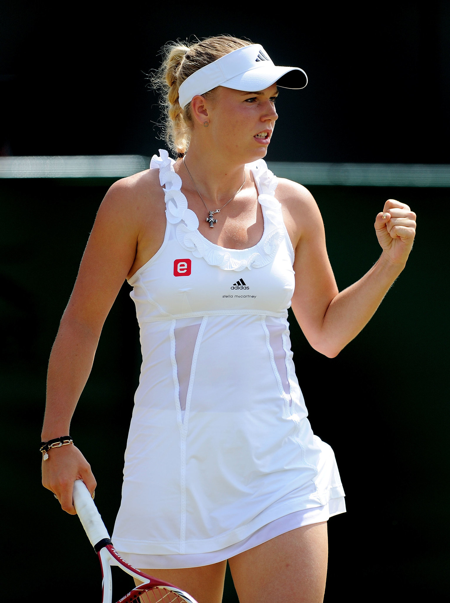 Caroline Wozniacki again showed off Stella McCartney's dress designs, but this time in white. Which one do you prefer?