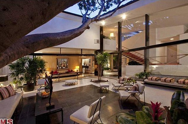 Large glass windows lead out onto the courtyard.  Source: MLS