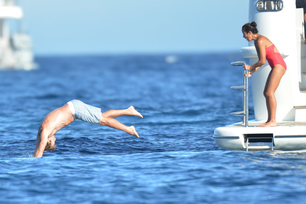 On Friday, Simon Baker dove off a yacht in Saint-Tropez, France, as wife Rebecca Rigg looked on.