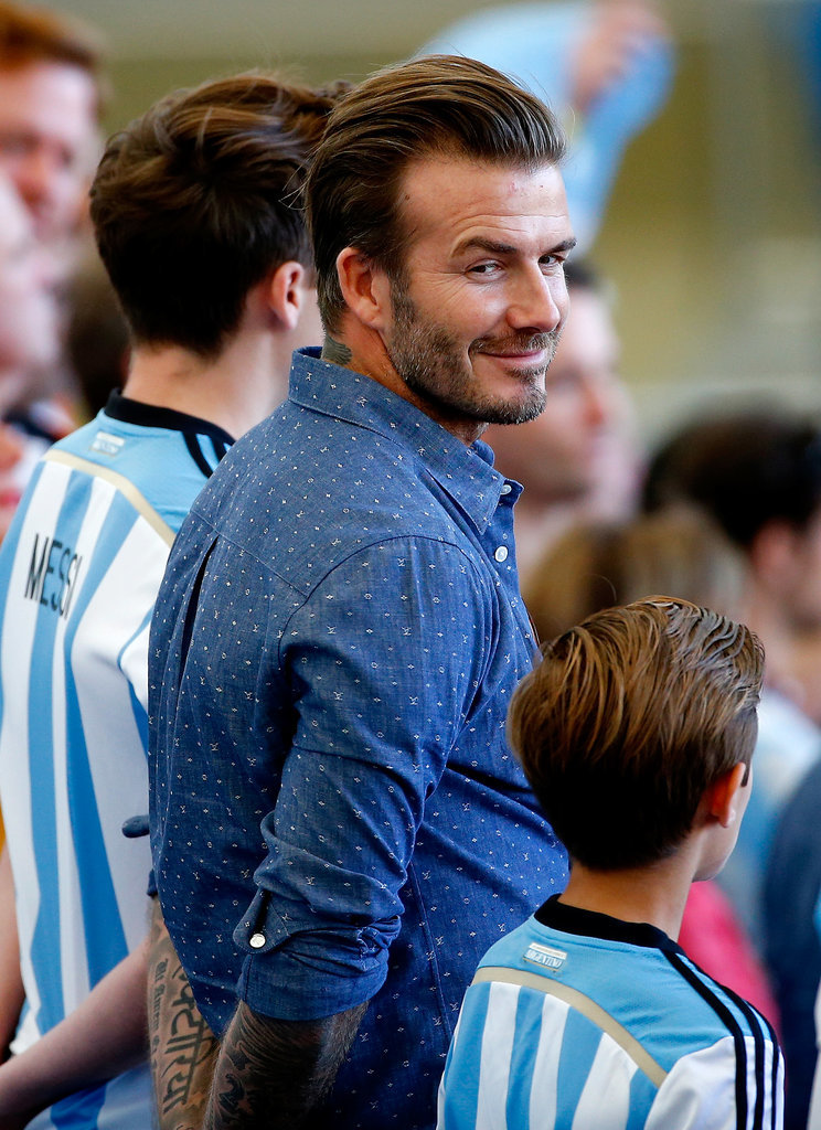 David Beckham hang out with his sons in the stands.