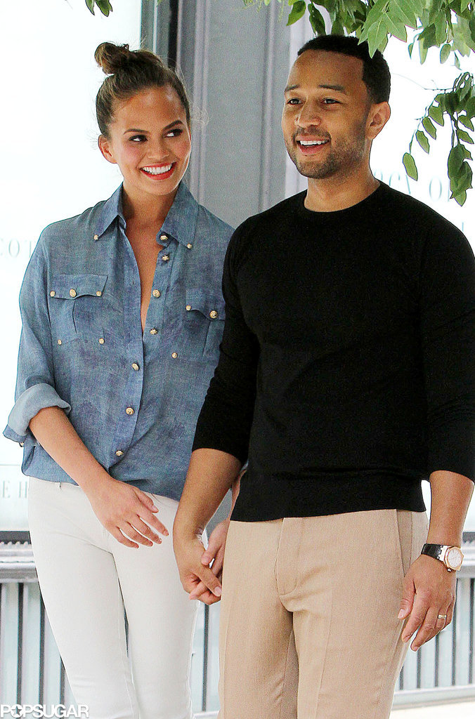 Chrissy Teigen looked adoringly at John Legend during a photo shoot outside their home in NYC on Friday.