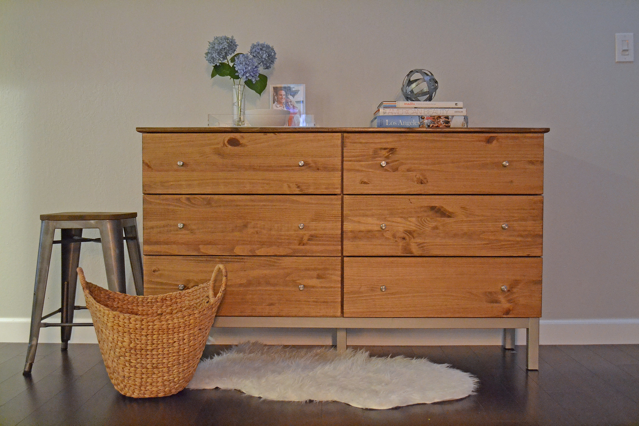 All it took was three simple steps to give it a new look! First, she stained it. When it comes to staining untreated wood, try brushing on a coat of conditioner first so that the stain goes on evenly. Photo: Lauren Turner