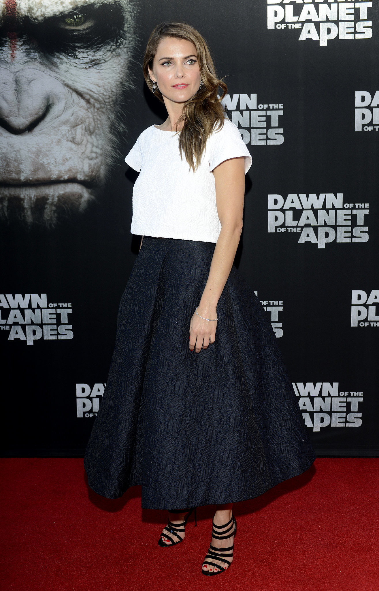 She's done the crop top thing — on the red carpet, no less