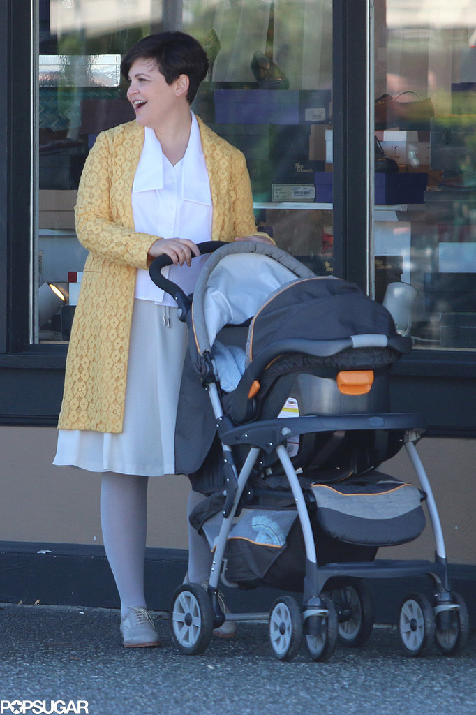 Snow White (Ginnifer Goodwin) pushed around a stroller.