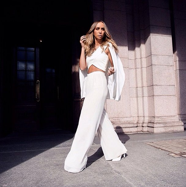 Sleek, milk-white trousers scream Summer, and a crisscross crop top is the ultimate wa
