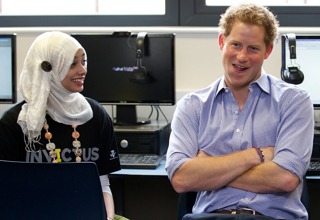 Prince Harry sat with a student at an Invictus Games initiative in London on Monday.