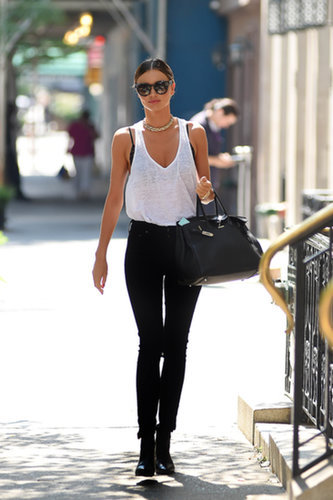 On a warm day, Miranda aimed for edgy in black denim, leather booties, and a chunky choker, but balanced her darks with a breezy tank.