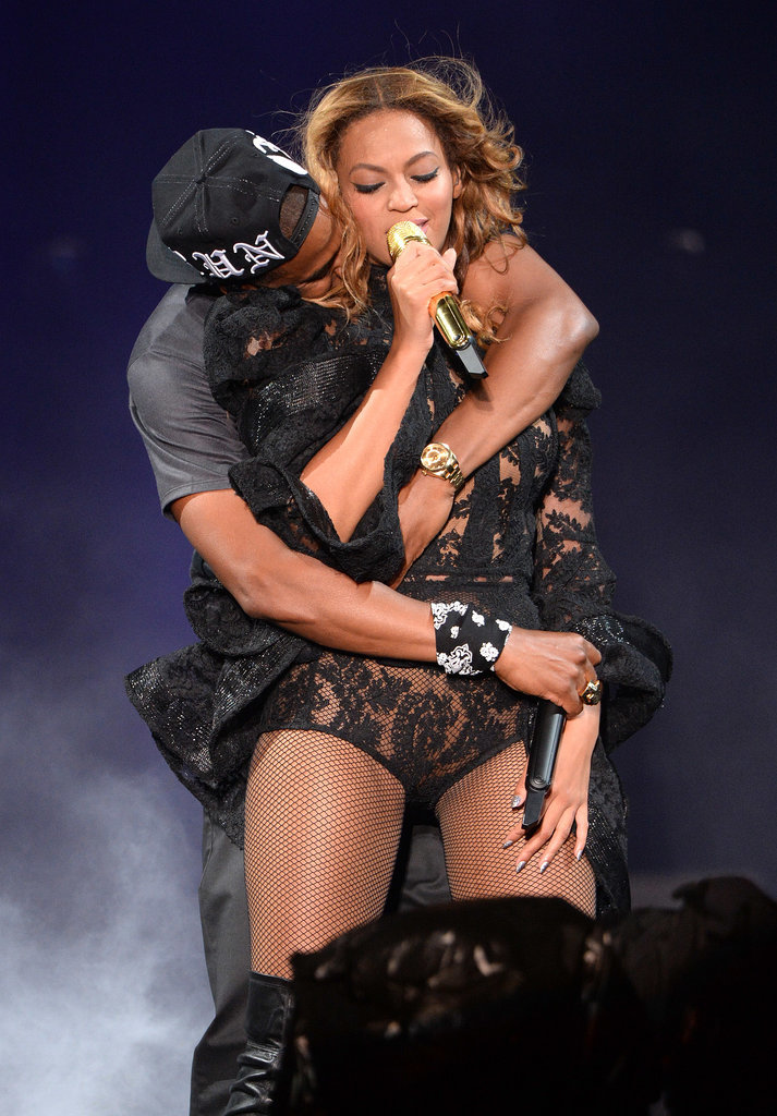 """Beyoncé and Jay Z showed onstage PDA during their """"On the Run"""" Tour stop in New Jersey in July 2014."""