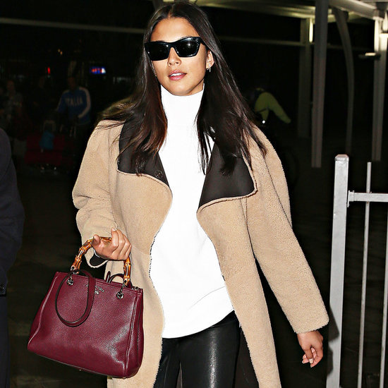 Jessica Gomes Lands at Sydney Airport Wearing a Camel Coat