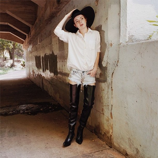 Ultramini denim shorts and a white blouse are sort of like a blank canvas for Summer nights. To really turn heads, a giant fedora and high-rise boots, like this to-die-for Givenchy pair, make for appropriate accoutrements. Source: Instagram user seaofshoes
