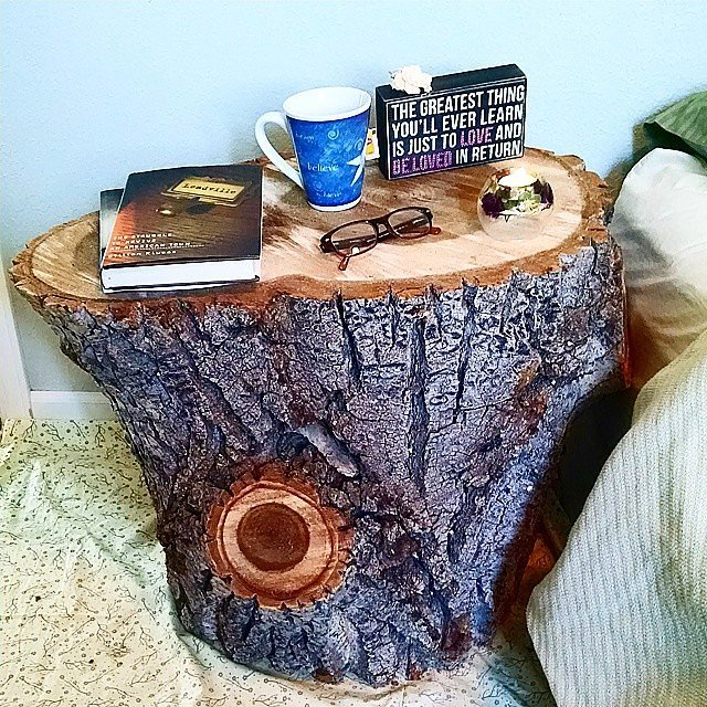 If you love rustic style, incorporate it into your bedroom decor with a tree-stump nightstand. With a bedside table this captivating, you won't need to add anything else!