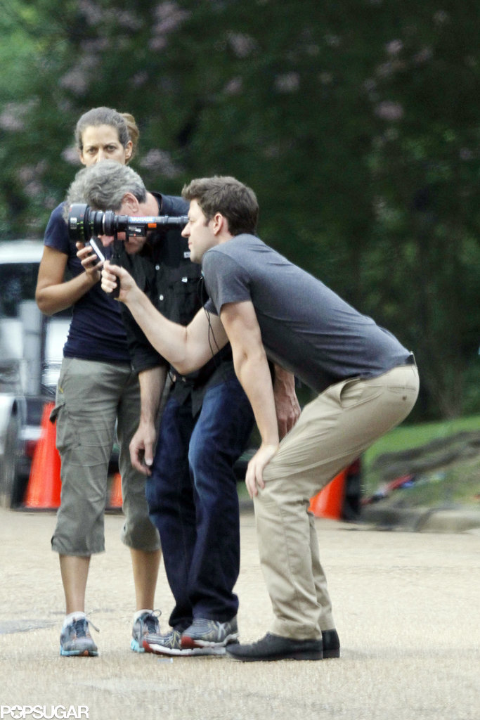 On Friday, John Krasinski looked comfortable behind the lens while directing his upcoming movie, The Hollars, in Jackson, MS.