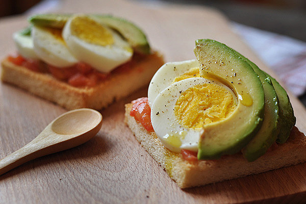 "5. Egg and Avocado Breakfast Pizza  Eggs and avocado pair perfectly together for a filling breakfast that is rich in both protein and healthy fats. In fact, recent research found that eating half of an avocado at a meal may help people feel more satisfied and reduce between meal snack cravings. Plus, studies show that eating eggs for breakfast reduces hunger and decreases calorie consumption at lunch and throughout the day. To Make: Toast a whole-grain pita round or piece of toast until slightly crisp. Top with half of a small avocado, mashed, and a squeeze of lemon juice. Then top with a sliced hard-boiled egg, salt, pepper, and a drizzle of salsa, if desired. 6. Overnight Oats  These oats won't take anytime out of your morning because you make them entirely the night before! Plus, they are a twist on traditional oats since they are a cool refreshing breakfast option that you can slurp right from the jar! Oatmeal's soluble fiber can help keep cholesterol levels in check and the number on the scale down, but since this recipe also contains nonfat Greek yogurt, it packs a one-two punch. A study that followed 120,000 people over 20 years found that yogurt was the number one food that was associated with keeping weight off long-term — more than even fruits, veggies, and grains! To Make: The night before, combine 1/3 cup old-fashion oats, 1/3 cup nonfat plain Greek yogurt, 1/3 cup skim milk, 1/2 cup berries of your choice, 2 tbsp. chopped nuts, and a drizzle of honey in a mason jar (or other tall container with a lid). Refrigerate overnight and enjoy slurping straight from the jar the next morning! Photo: Tailor Tang More from Self.com:  Tips From A Mudderella Trainer For Your Best Mud Run Yet! Should ""Added Sugar"" Labels on Food Be Mandatory? Drink Your Greens With These Healthy Kale Recipes"