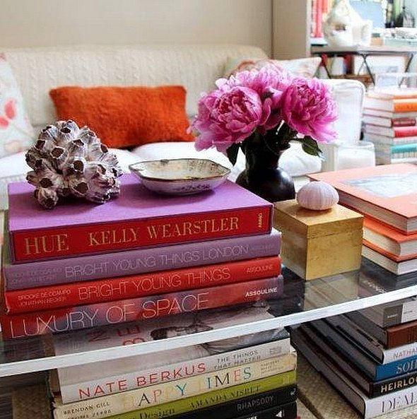 Add texture and personality to your space by using your favorite reads as layering tools on your coffee table. Top them with trinkets or fresh flowers for a look that's glamorous but laid-back. Source: Instagram user ambriinteriors