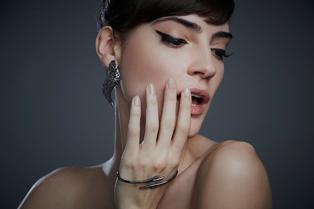 Raven Wing Post Earrings ($285) and Raven Branch Handcuff ($155)
