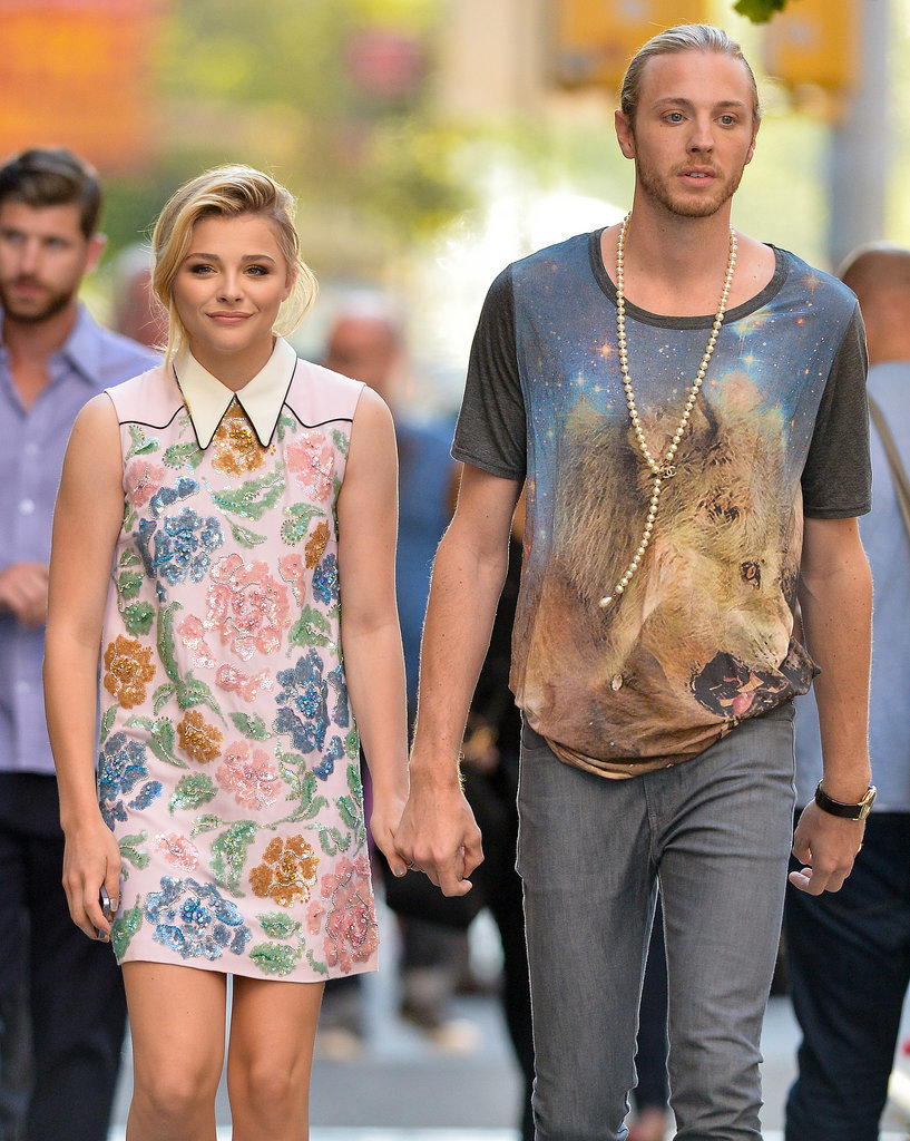 Chloë Moretz held onto her brother Trevor's hand while walking around NYC on Monday.
