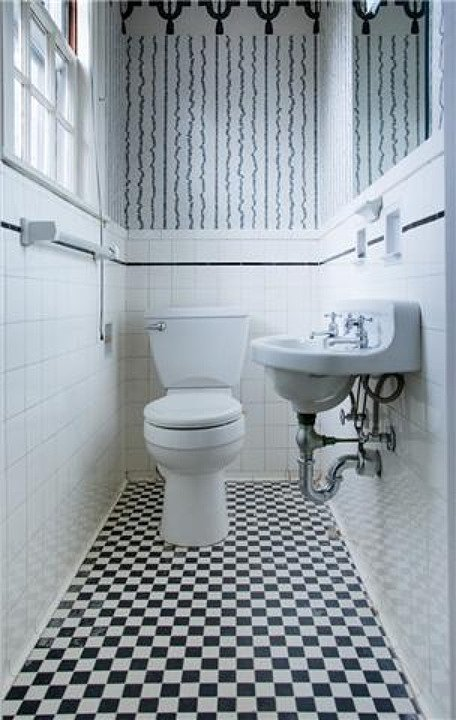 This bathroom is small, but the vintage touches are perfect for a histor
