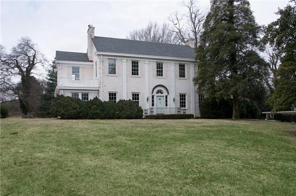 From the front, one might never guess that this house requires an overhaul.  Source: Zillow