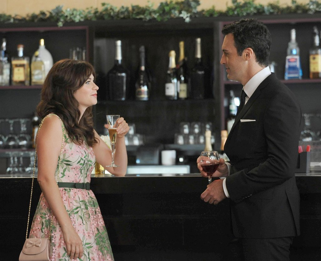 "Jess (Zooey Deschanel) meets a handsome best man (Reid Scott) in New Girl episode ""The Last Wedding."""
