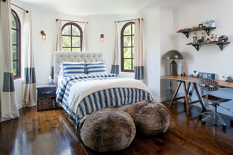 This bedroom gets an extra dose of glam with furry poufs. Source: David Offer Fine Homes