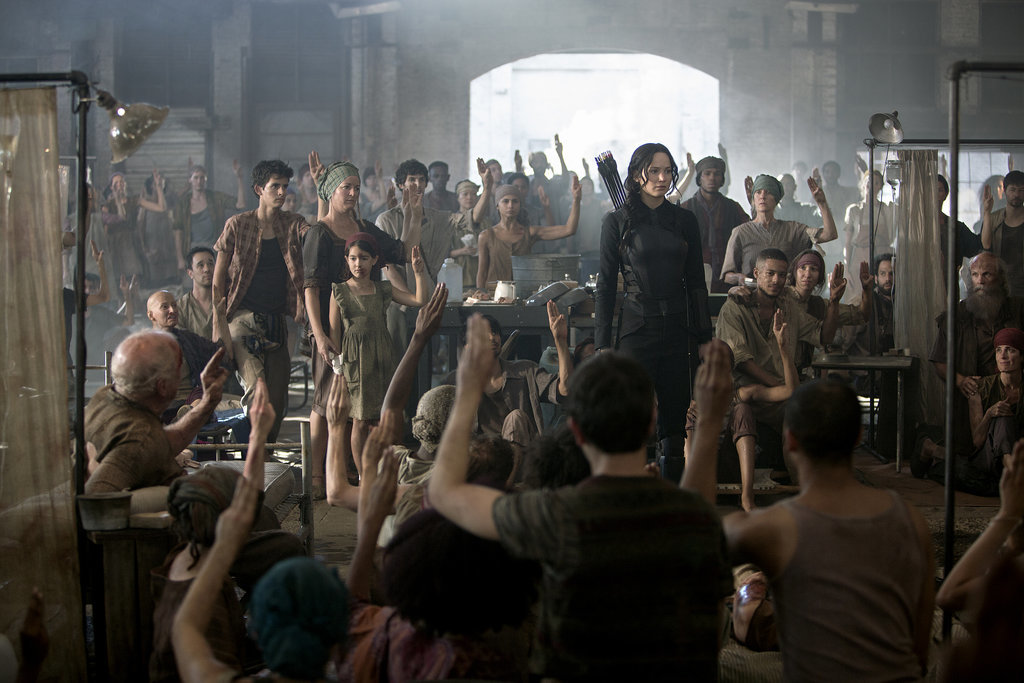 Everyone salutes the Mockingjay.