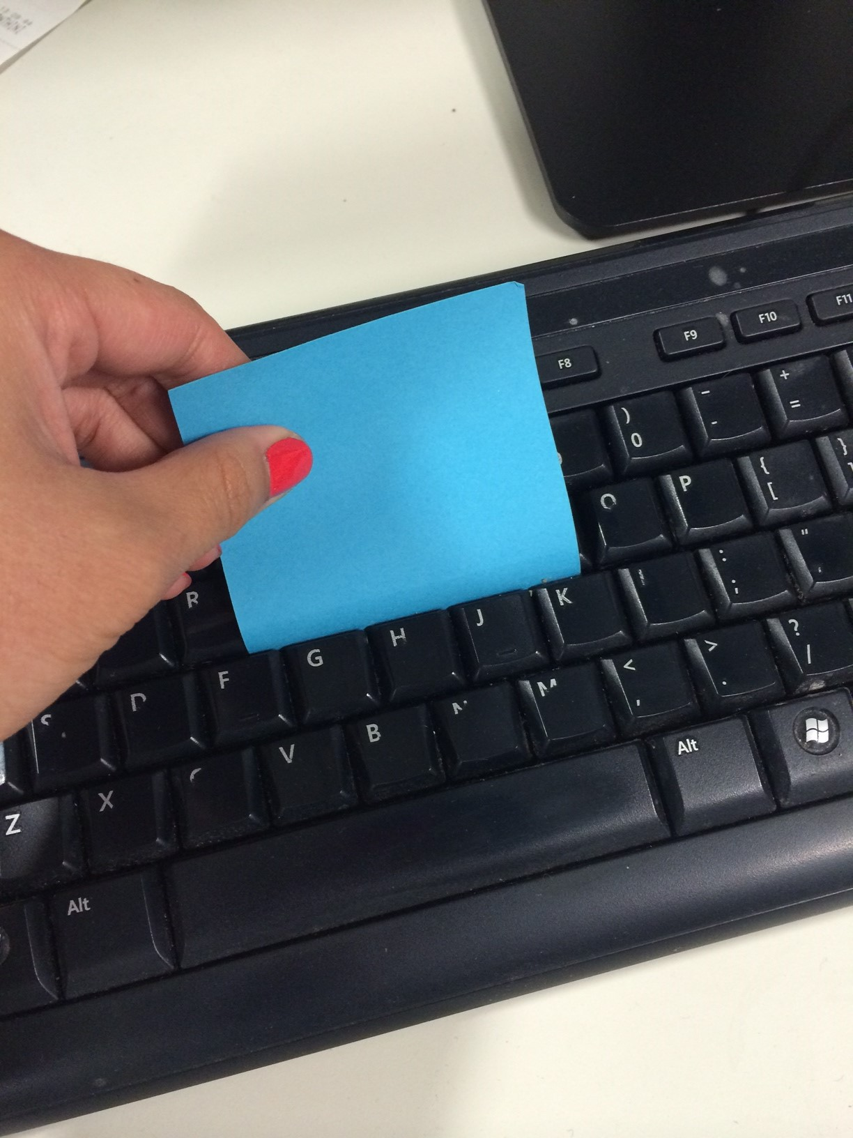 how to clean your keyboard with a sticky