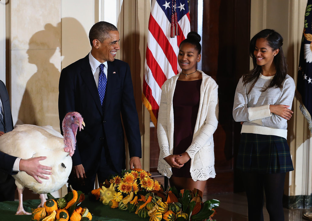 Malia and Sasha laughed as their dad pardoned the turkey on Thanksgiving.