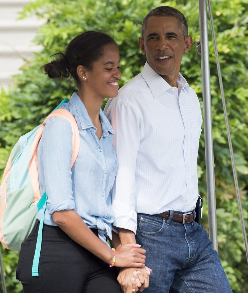 President Obama held hands with his older daughter when they jetted to Martha's Vineyard in August.