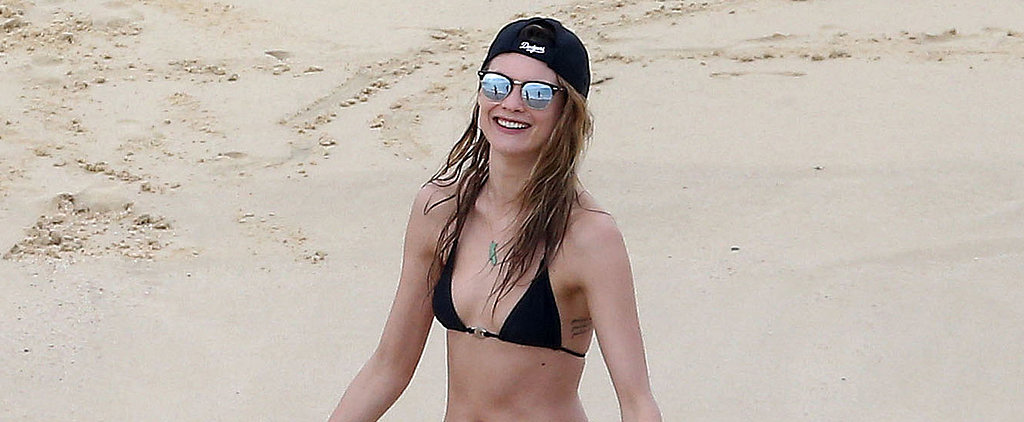 Behati Prinsloo Celebrates the Holidays With a Bikini Beach Trip