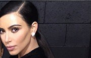 Kim Kardashian FINALLY Reveals Why She Never Smiles In Pictures