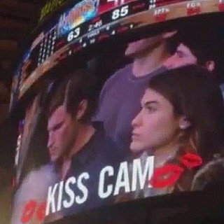 Woman Kisses Stranger Next to Her on Kiss Cam