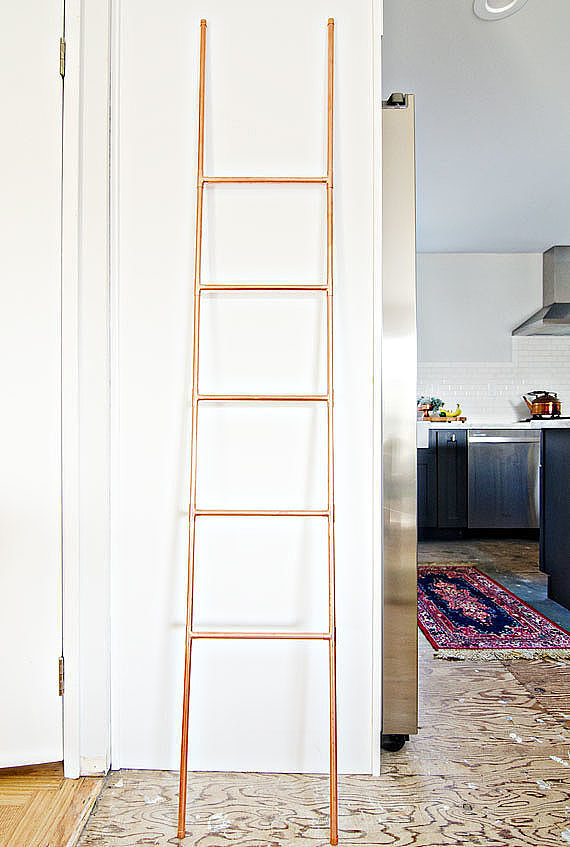 This DIY copper ladder is perfect for organizing everything from throw blankets to towels.