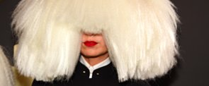 """Thoughts on Sia's """"Cousin It"""" Coif on the Grammys Red Carpet?"""