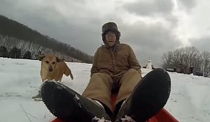 90-Year-Old Veteran Goes Sledding With Dog